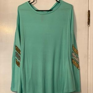 Boutique long sleeved shirt.